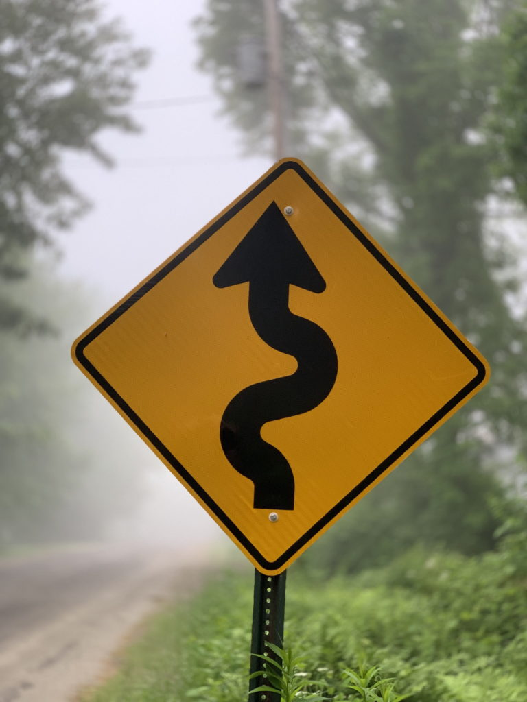 signpost indicating bends ahead